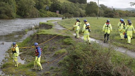 A coastguard search team searching  along the River Dyfi in Machynlleth