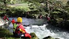 Members of a mountain rescue team search the River Dyfi as the hunt for missing April Jones continues