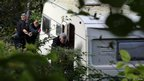 Police search a caravan close to the of village of Ceinws as part of the hunt for missing April Jones