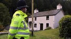 Police search Mark Bridger's house in the village of Ceinws as the hunt for missing April Jones continues