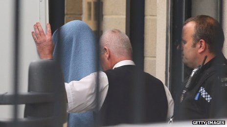 Mark Bridger is led into court in Aberystwyth under a blanket
