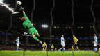 Joe Hart of Manchester City makes a save during the Uefa Champions League Group D match between Manchester City and Borussia Dortmund at the Etihad Stadium in Manchester