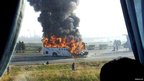 A tourist bus is engulfed in flames on an expressway near Tianjin, China 