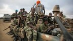 Soldiers of the Somali National Army are seen riding a machine-gun-mounted battle wagon