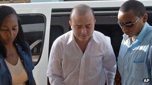 Angel Carromero (C) is brought to trial in Bayamo, Cuba, 5 Oct 2012
