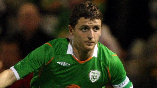 Alex Bruce in action for the Republic of Ireland against Poland four years ago