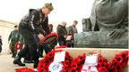 Motorcyclists lay their wreaths as part of the fifth Ride To The Wall