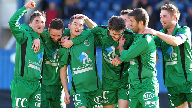 Ballinamallard players celebrate their 3-1 victory over Linfield at Windsor Park 