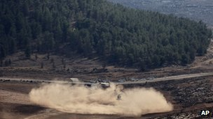 Israeli helicopter lands near site of downed drone. 6 Oct 2012