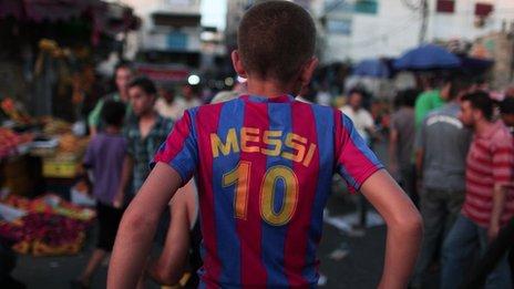 Palestinian boy on motorbike with Messi shirt