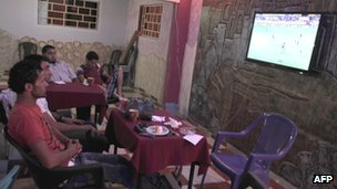 Palestinians in Rafah coffee shop watching La Liga match between Sevilla and Barcelona - 29 September