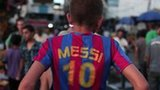 Palestinian boy on motorbike with Messi shirt