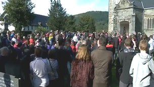 Hundreds stood outside the church
