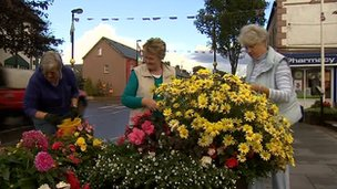Broughshane locals tending flowers