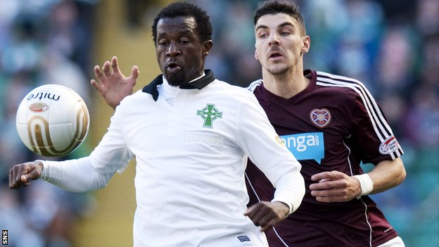 Celtic defender Efe Ambrose (left) holds off Callum Paterson