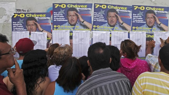 Voters and Chavez posters