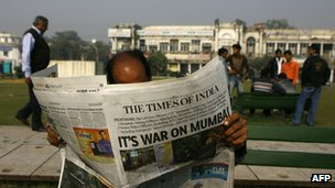 A man reading Times of India newspaper in Mumbai