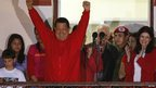 Venezuelan President Hugo Chavez celebrates from balcony at Miraflores Palace in Caracas.