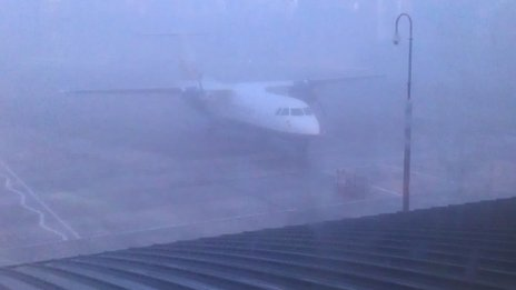 An aircraft at a foggy airport