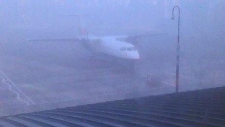 An aircraft at a foggy airport