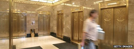 A worker walks past Art Deco-era elevators inside the new Hard Rock Hotel in Chicago, 2004 