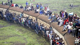Passengers on an overloaded train in Nairobi