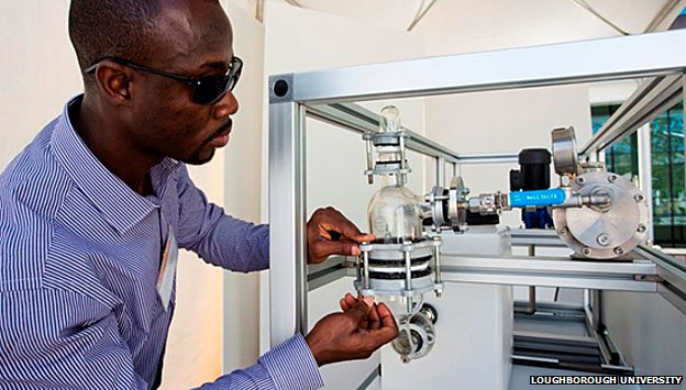 Eric Danso-Boateng, PhD student in Loughborough University's chemical engineering department, makes adjustments to their prize-winning prototype loo
