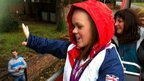Ellie Simmonds waving at supporters from open top bus