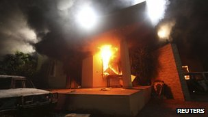 The US Consulate in Benghazi is seen in flames during a protest by an armed group in this file photo 11 September 2012