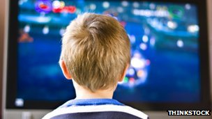 Boy in front of screen