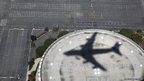 Air Force One casts a shadow over The Forum in Inglewood