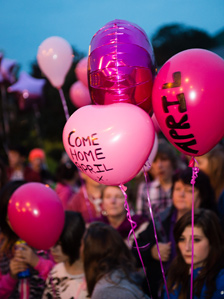 Pink balloons with messages for April