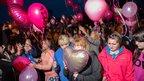 Mair Raftree kisses a balloon dedicated to April