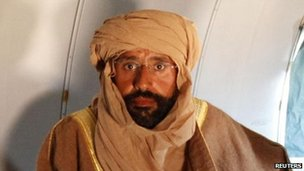 Saif al-Islam sitting on a plane after he was captured by rebels in Zintan