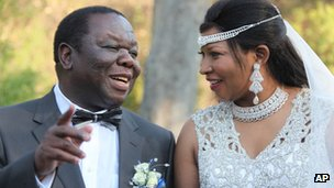 Zimbabwean Prime Minister Morgan Tsvangirai, left, is seen with his wife Elizabeth Macheka during a traditional wedding ceremony in Harare, Saturday, Sept. 15, 2012,
