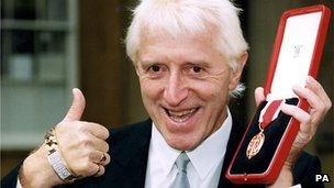 Sir Jimmy Savile after receiving his knighthood in 1996