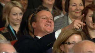 David Cameron laughs and points during Boris Johnson's speech