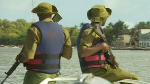 Security guards in boat