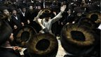 Ultra-Orthodox Jewish men dance during Simchat Torah celebrations