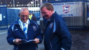 Club security staff look through the fanzine
