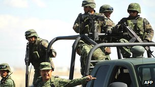 Mexican army troops at a murder scene in Ciudad Juarez, Mexico (March 2013)