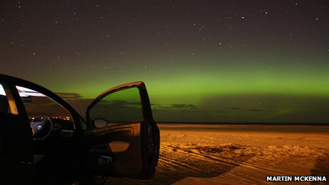Aurora over beach