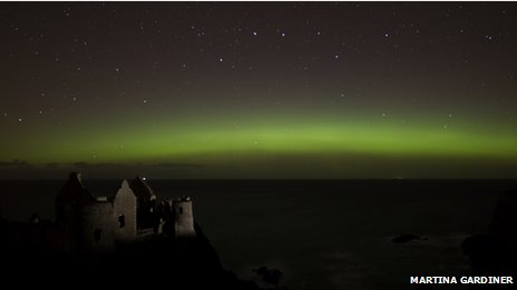 Aurora over Dunluce Castle