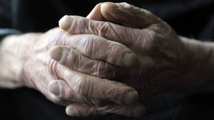 The hands of an elderly man