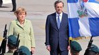 German Chancellor Angela Merkel and Greek Prime Minister Antonis Samaris at the airport in Athens