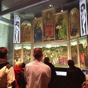 Tourists look at the altarpiece