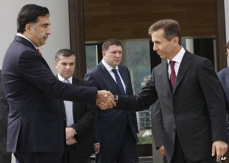 Mikheil Saakashvili (left) shakes hands with Bidzina Ivanishvili in Tbilisi, 9 October