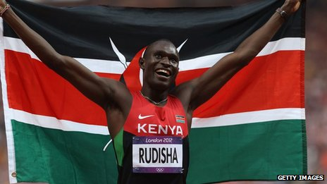 David Lekuta Rudisha of Kenya celebrates with his country's national flag after winning gold and setting a new world record of 1.40.91 in the Men's 800m Final on Day 13 of the London 2012 Olympic Games at Olympic Stadium on August 9, 2012 in London, England.