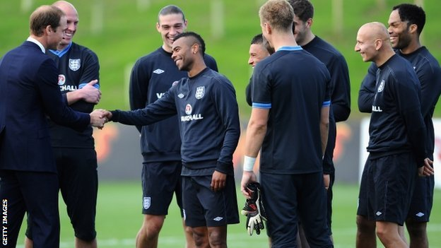 The Duke of Cambridge shakes Ashley Cole's hand