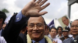 Burma's President Thein Sein waves to supporters upon his arrival at Yangon International Airport as he returned from the US tour on 1 October, 2012